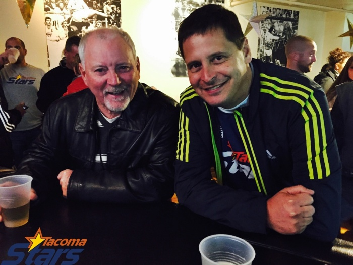 "Joe Waters (left) and Stars owner Lane Smith. Waters was honored before the match and took the ""first kick"" as a Stars legend from the MISL days. (John Crouch)"
