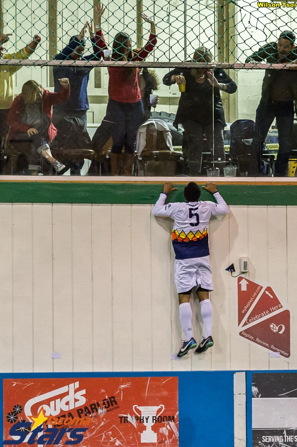 Cox climbs a wall to celebrate Tacoma's first goal in the WISL Final. (Wilson Tsoi)